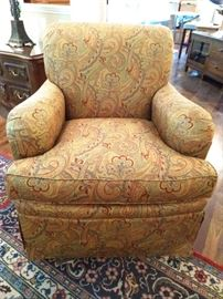 One of a pair of Grizzel And Mann paisley upholstered armchairs.