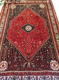 "Vintage hand woven Persian Qashqai rug, 100% wool face, measures 10' 7"" x 7' 3""."