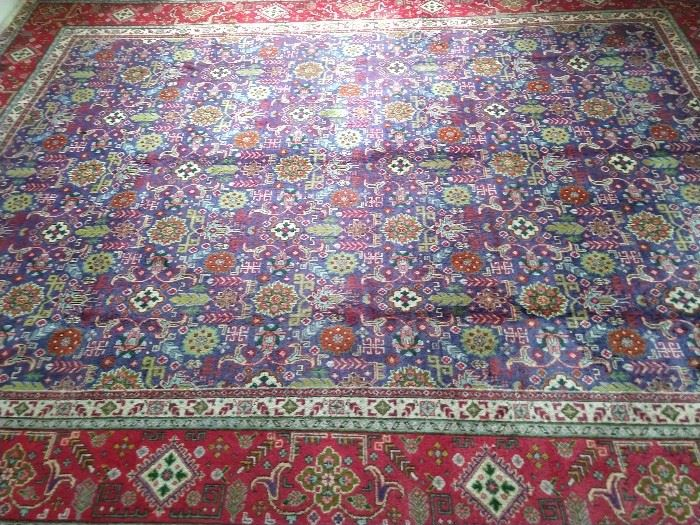 This 10' x 12' vintage Persian Kashan sets the mood for doing it like animals, on the Discovery Channel.