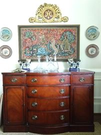 1940's vintage Drexel New Travis Court mahogany buffet, pair of hand painted plates by Christine Viennet, (France) collection of crystal decanters, unusual beaded tapestry.                                                                                      Overhead is a vintage French heraldic fragment - yummy!
