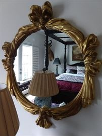 Carved wood, gilt wall mirror.