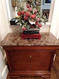 "3-drawer marble top side chest, by Stickley Furn. Co., each drawer centering a shield escutcheon with key, the whole rising on four bracket feet, measures 30""h x 32""w x 17""d."
