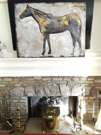 "Nicely rendered original oil on canvas (40"" x 40"") horse art, above natural stone fireplace, complete with two sets of fire tools, vintage brass andirons and coal hod."