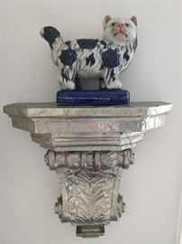 One of a pair of hammered tin/mahogany wall sconces, with Staffordshire-style fat cat.