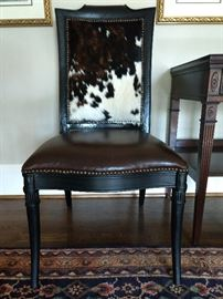 One of a pair of leather/cowhide upholstered mahogany side chairs.
