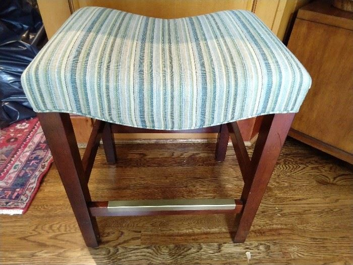 Pair of striped linen upholstered low barstools.