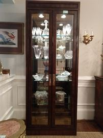 One of a PAIR of Drexel Heritage Mahogany lighted curio cabinets, wit mirrored back and three beveled glass sides.