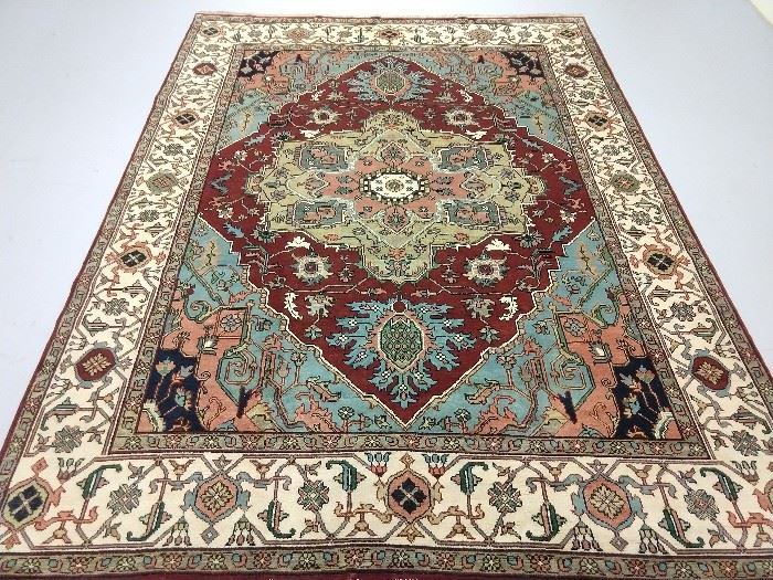 Lovely hand woven room sized Persian design Heriz rug, 100% wool face, measures 9' x 12'.