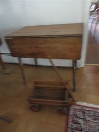 Drop leaf table and wagon.