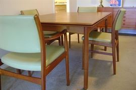 4 mid-century teak side chairs and 2 arm chairs.