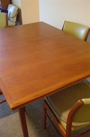 Solid teak dining table measures 84 inches with leaves attached and 60 inches without.