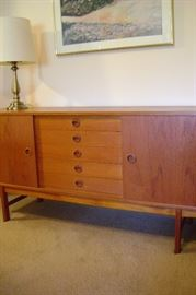 Solid teak dining server/credenza measures 71 by 19.                 2 - sliding cabinets and 5 drawers.