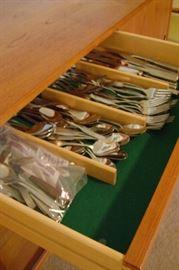 Oneida stainless silverware, including serving utensils.