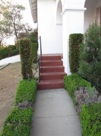 A close-up of the front stairs, including the 90 degree turn on the porch.
