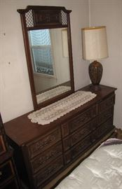 There is a mirrored dresser also available .