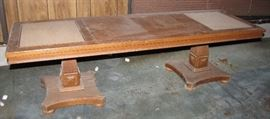 """This coffee table has two """"inlaid"""" tiles sitting in the top.  It also needs dusting and some TLC."""