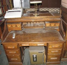 One of the two roll-top desks available in the sale.