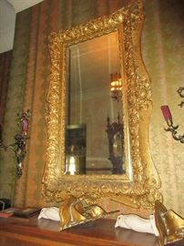 Large carved and gilt mirror