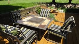 Fire pit table, 4 matching chairs with cushions