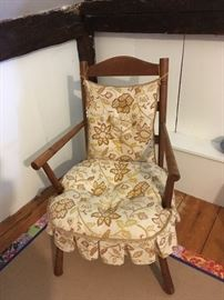 Vintage upholstered chair.  Rug below is for sale as well.