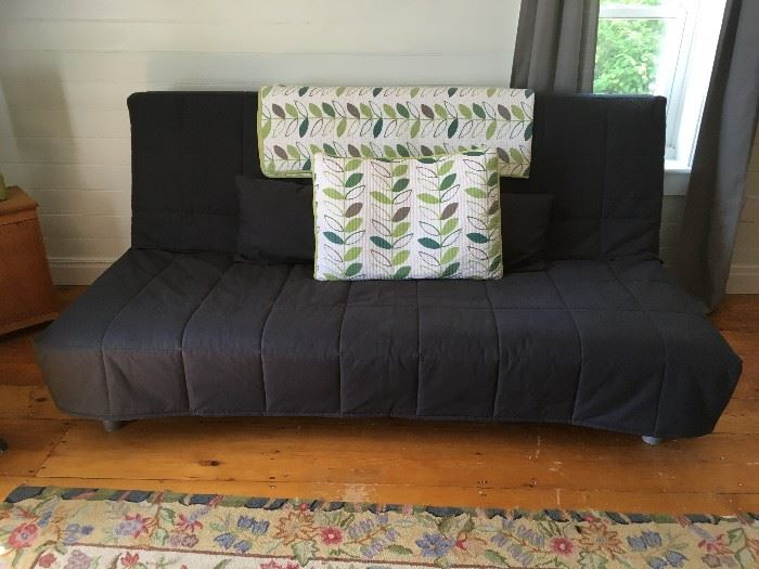Awesome IKEA full-sized futon which has barely been used.  The futon comes with this grey cover, a mattress pad, and all pillows.  The comforter on the back and matching pillow are also for sale.