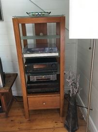 Media center and all stereo equipment on it are for sale, separately or as a whole package.  The large vase next to the media center is for sale as well.