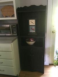 Vintage black kitchen cupboard has great storage.