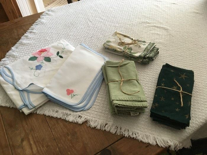 New Italian cloth tablecloth and napkins, and assorted cloth napkin sets.  Other linens will also be for sale.