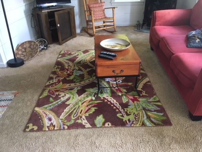 Beautiful Company C rug for sale! In this photo, couch, rocker, and pie safe are also for sale.  The coffee table is for sale, the African basket and pottery are not for sale.