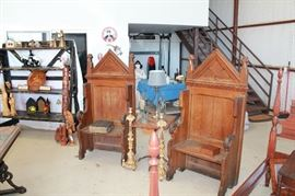 Deacon chairs and antique French gilt altar candle sticks.