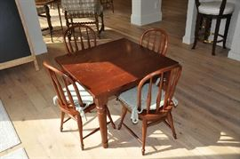 "Kid's table and four chairs with custom-made seat cushions; great for homework, playdates and after school snacks; table is 30"" x 30"" x 22""; take this home for $150!"