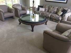 Exquisite leather club chairs by Brayton, couch with black leather piping, round glass coffee table - all designer items