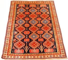 Kazak Style Rug - This Indo Persian wool area rug features a Kazak style design and measures 8' x 10'.