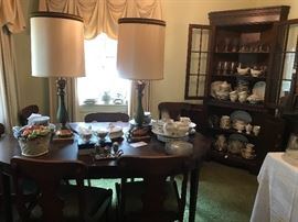 Cherry Dining room table with cushioned bottom chairs along with corner China cabinet