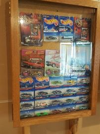 Hot Wheels cars NIB and displayed carefully in enclosed cabinets, plus a whole bunch more NIB cars