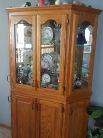 Cabinet is secured to the floor and wall, but all the amazing knick knacks inside are for sale!