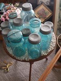 Antique blue Ball canning jars with original galzinized lids