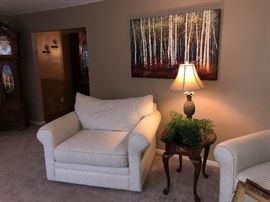 Family Heritage Estate Sales, LLC. New Jersey Estate Sales/ Pennsylvania Estate Sales. White Armchairs. Endtable. Decorative Lamp. Art.