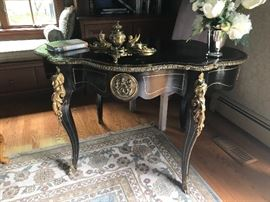 19th Century Gilt Bronze Mounted Brass inlay ebonized center table, gilt tooled black leather writing surface, cabriole legs, headed by caryatids.