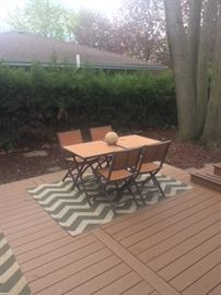 Patio table, chairs and rug