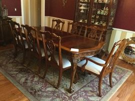 Beautiful wood dining table with chairs matching side board server and matching china hutch from Scott Shuptrine Furniture in excellent like new condition