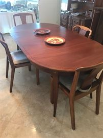 Baker mid century table with extensions to seat 12, 4 chairs