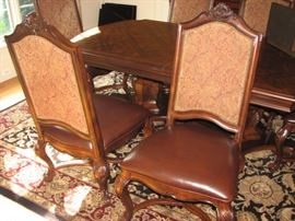 Plunkett Dining table with 2 leaves and 6 chairs.  At full size, seats 10 comfortably.