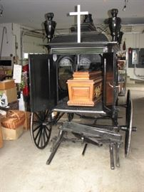 Antique hearse - a horse drawn sleigh / carriage.  Includes casket.