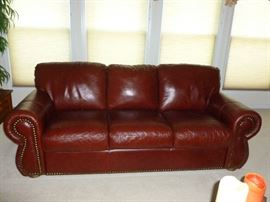 Like new leather sofa w/tack trim