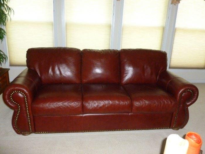 Like new leather sofa w/tack trim