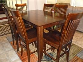 Beautiful high-top table w/built-in leaf & 8 Stools..see next photo for other 2 stools