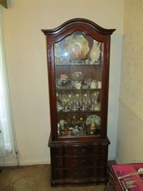 Hammary display cabinet with three drawers, antique glassware, porcelain