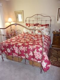 Antique iron full bed Metal frame in bronze with mattress and box springs. Does not include linens.