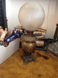 Very large brass and frosted glass oil lamp
